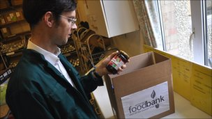 Foodbank volunteer Graham Herbert with a food box