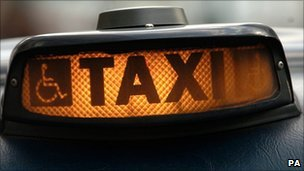 Close up of sign on London taxi