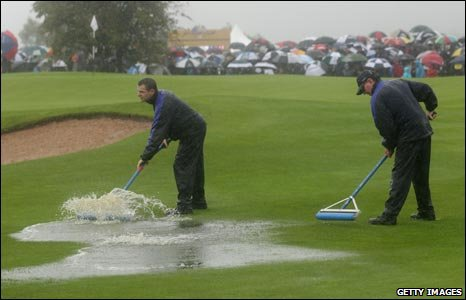 Celtic Manor groundstaff clear water off the first fareway
