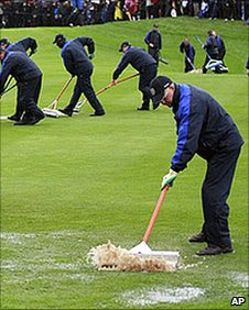 Ground staff at Celtic Manor try to clear the course of water