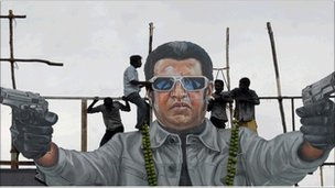Fans of Rajinikanth pour milk as an offering over his cut-out on the release date of his new movie Endhiran (Robot) in Madras on 1 October 2010