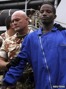 Spanish navy officials hand over suspected Somali pirate, Mombasa, 29 September