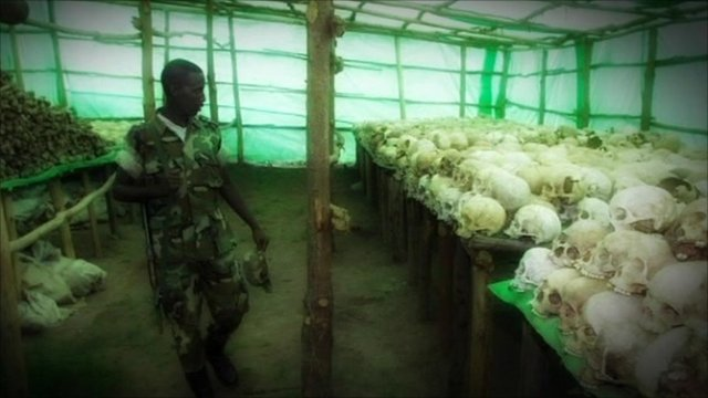 Soldier looking at skulls