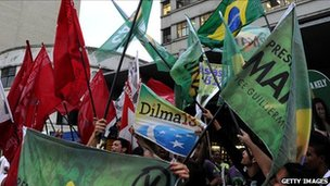 Brazilian supporters of presidential candidate for the Green Party (PV), Marina Silva, wave green flags while supporters of the candidate for the Workers' Party (PT), Dilma Rousseff, wave red flags, Rio de Janeiro, Brazil, on September 29, 2010