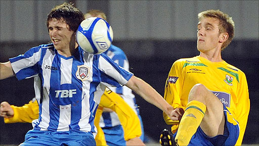 Coleraine defender Howard Beverland in action against Andy Graham of Newry City