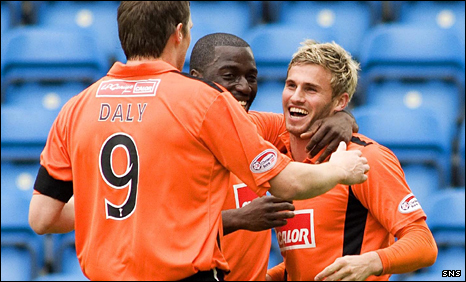 Dundee United striker David Goodwillie is congratulated by his team-mates after firing the visitors in front at Rugby Park