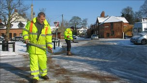Council workers shovelling grit, gritting roads in Leicestershire, England, Feb 2009