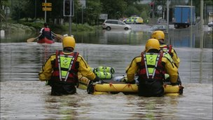 Fire rescue team with a boat, dingy in a flooded road, street Tewkesbury, July 2007
