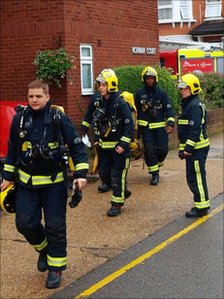 Firemen prepare to enter an apartment in a building in Putney, south-west London, where two women died in a suspected copycat double suicide.