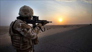 British soldier, airman on dawn patrol at sunrise in Basra, Iraq, Feb 2009.