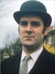 John Cleese in the bowler hat and suit