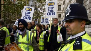 LONDON, UNITED KINGDOM: British civil service unions protesters are watched by police as the march through London 05 November 2004. Civil servants staged their biggest strike in more than a decade in a bitter row over jobs.