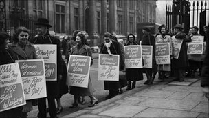 1952: Men and women take part in a protest march demanding equal pay for female employees of the British civil service.