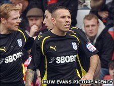 Craig Bellamy is congratulated after scoring for Cardiff at Barnsley
