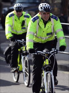 Two cycling Policemen