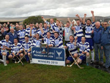 A jubilant Newtonmore side celebrate with the trophy