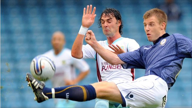 "Burnley""s Chris Eagles and Millwall""s Tony Craig battle for the ball"