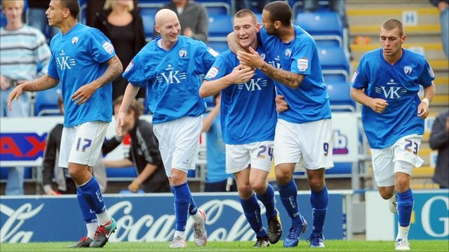 Chesterfield celebrate after Craig Clay (centre) makes it 5-5 in injury time