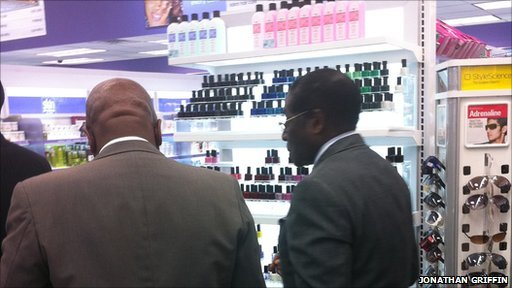 Zimbabwe's President Robert Mugabe shopping for his wife at a chemist in New York