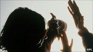 Actors portray domestic violence involving a man and a woman