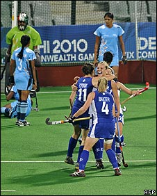 Holly Cram (11) celebrates her goal for Scotland against India in their hockey match