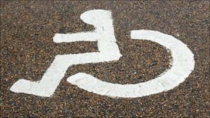 A disabled sign on a road