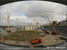 Construction workers work at a site of a new football stadium which is being built for Euro 2012 in Lviv, Poland