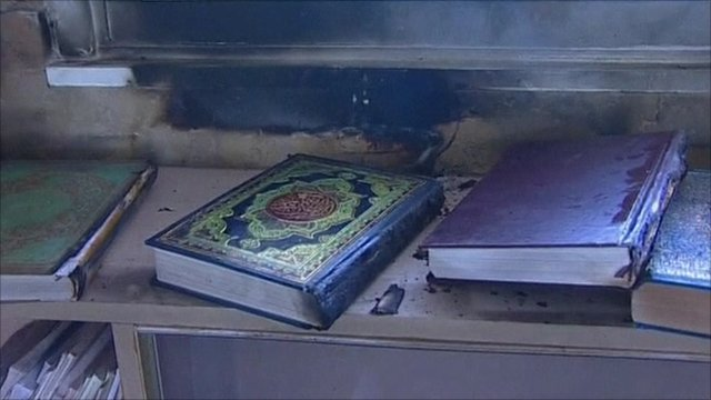 Copies of the Koran charred in the fire