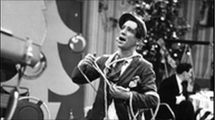 Sir Norman Wisdom at BBC TV's Christmas party in 1952