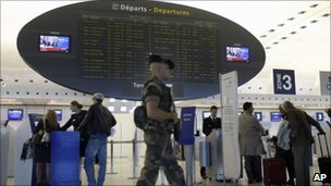 A soldier patrols Paris Charles de Gaulle airport - 4 October 2010