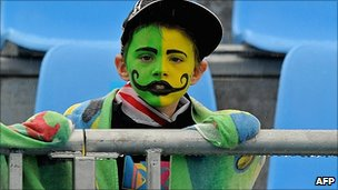 A young sports fan with painted face