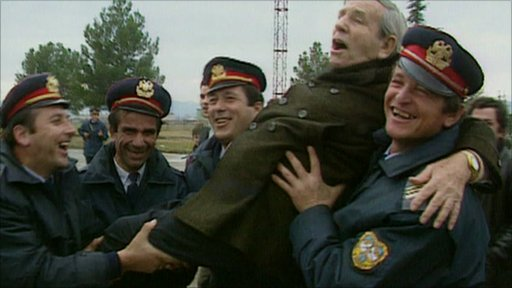Norman Wisdom being carried by Albanian police