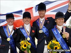 The British Dressage Team of (r-l) Nicola Wilson, Tina Cook, Willaim Fox-Pitt and Mary King celebrate after team gold at the World Equestrian Games