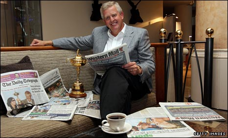 Colin Montgomerie savours the newspaper headlines