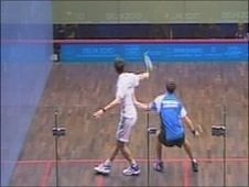 Chris Simpson playing Daryl Selby in the squash men's singles at the Delhi 2010 Commonwealth Games