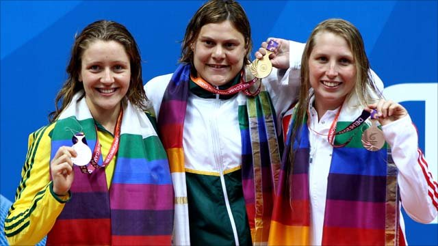 Medalists Annabelle Williams of Australia (Silver), Natalie Du Toit of South Africa (Gold) and Stephanie Millward of England (Bronze)