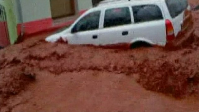 A car in the red sludge