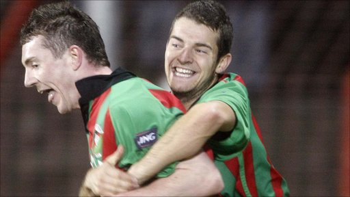 Glentoran's Mattie Burrows celebrates his late winner for Glentoran at the Oval