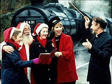 Singing carols at a train station