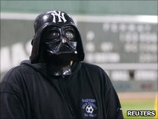 A New York Yankees fan in a Darth Vader mask during a rain delay