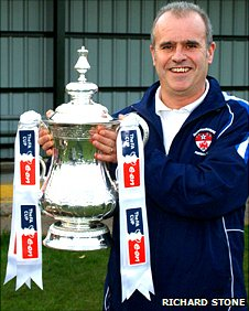 Radcliffe Olympic FC's manager Jamie Brodie holds the FA Cup Trophy