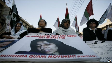 Supporters of Pakistani political party Muttahida Qaumi Movement take part in a rally demanding release and condemn the verdict against alleged Al-Qaeda suspect Aafia Siddiqui, in Karachi, Pakistan on Tuesday, Sept 28, 2010