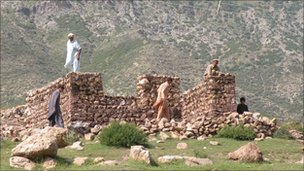 Turi tribesmen building a house of rocks in Parachinar area