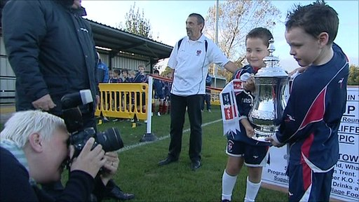 Radcliffe Olympic Juniors hold the FA Cup Trophy