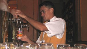 Barman pouring beer in Bar Brahma, Sao Paulo