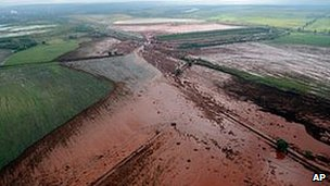 Red chemical sludge covers land outside Devecser, Hungary, (file image from 6 October 2010)