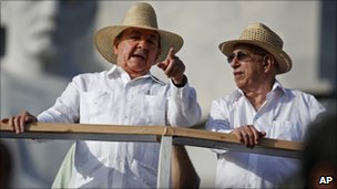 Cuba's President Raul Castro, left, wearing a guayabera shirt, speaking to Vice-President Jose Ramon Machado Ventura, Havana, May 2010