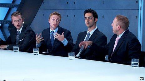 The boys team in the boardroom