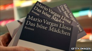 Copes of the German translation of Vargas Llosa's 2006 work - Travesuras de la Nina Mala, translated in English as The Bad Gir - on display at the Frankfurt book show