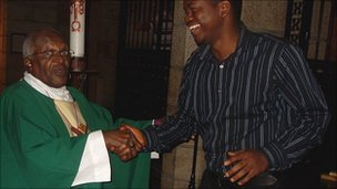 Max Katta shaking hands with Archbishop Desmond Tutu
